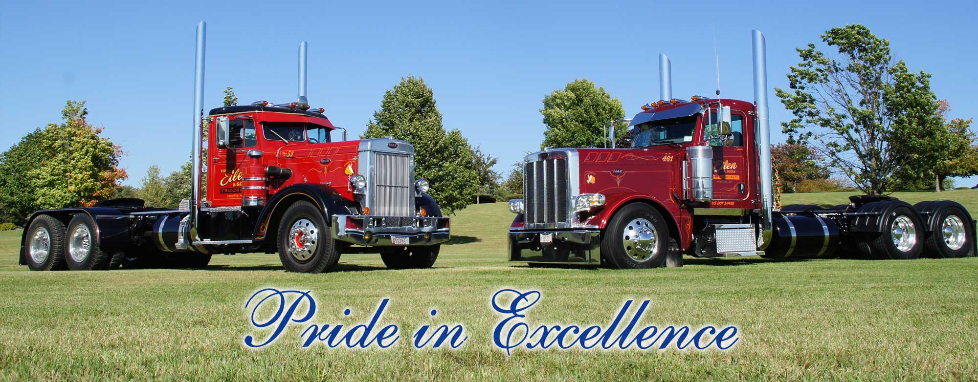 Pair of Eilen & Sons Trucking show trucks facing each other parked on green grass | Pride in Excellence