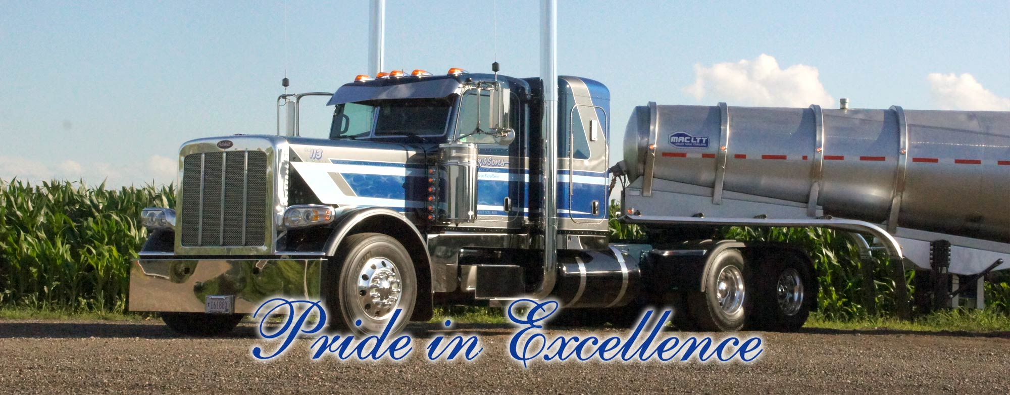 Eilen & Sons white and blue stripped semi truck hauling a belly dump trailer | Pride in Excellence