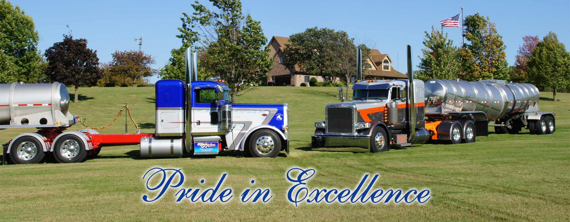 Pair of Eilen & Sons Trucking show trucks with belly dump trailers facing each other parked on green grass | Pride in Excellence